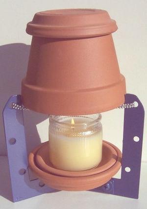 calentar la casa en invierno con una maceta y una vela por menos